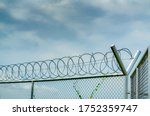 Prison Security Fence. Barbed...