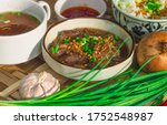Beef Pares with garlic rice and chili sauce