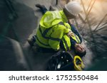Small photo of Construction worker accident, Accidents at work, Builder accident fall scaffolding to the floor, Safety team help employee accident, Basic first aid training for support accident in site work.