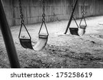 Empty Swings In Black And Whit...
