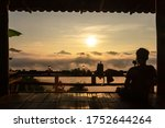Silhouette Of Tourist On Woode...