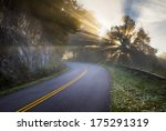 Blue Ridge Parkway North Carolina Sun Rays of Light beam through the trees along the road in the Appalachian Mountains in western NC - stock photo