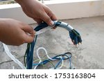 An Electrician Is Winding The...