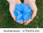 Child Hands Holding Blue...