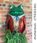 Frog Garden Statue With Plant