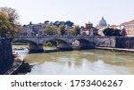 Skyline with bridge Ponte Vittorio Emanuele II and classic architecture in Rome, Vatican City scenery over Tiber river.