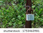 An Old Rusty Padlock Hangs On A ...