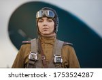 A Young Female Pilot In Uniform ...