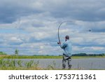 Male Fisherman. Throws A...