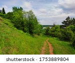 Path On A Green Hillside With...