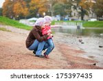 mother and daughter together on ... | Shutterstock . vector #175397435