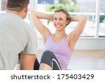 male trainer assisting fit... | Shutterstock . vector #175403429