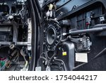 Small photo of St. Petersburg, Russia - June 08, 2020: The interior of the car Range Rover Sport with a dismounted lining with many colored wires and parts. car repair after an accident. Thorough troubleshooting