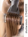drying long brown hair with... | Shutterstock . vector #175409999
