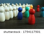 Small photo of Inclusive and discrimination concept. Lines of wooden figurines and different ones as symbol of diversity.