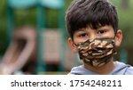 Hispanic Boy Wearing Mask With...