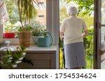 Rear View Of A Senior Woman...
