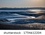 Sunset View Of Tidal Flats Of...