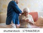 Woman Helping Senior Woman...