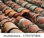 Small photo of Old dirty roof with misplaced tile middle