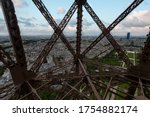 Paris panorama view front Eiffel tower lift throughout the steel bars screwed to each others, France