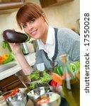 beautiful woman in kitchen is... | Shutterstock . vector #17550028