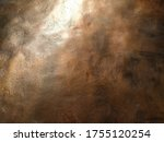 Small photo of Copper texture background. Bronze texture. Bent metal with dents. Close-up of a bronze surface. A reflection of light in a bent place