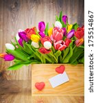 tulips in the box on wooden... | Shutterstock . vector #175514867