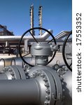 Detailed view of a refinery with focus on valve controls. - stock photo