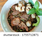 Small photo of Thai Boat noodles soup or Guay tiew reua ,Rice noodles thicken soup with stewed pork , pork ball ,Braised pork and liver pork ,Thai boat noodles is Thailand's most famous noodles soup, Thai local food