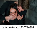 Man\'s Hand Covering Her Mouth....