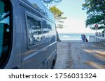 Campervan Parked By The Sea Side