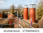 Clay chimney pot with cowl on a ...
