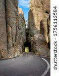 The needles eye tunnel is a narrow one lane road cut through the stone of the Black Hills in South Dakota near Mount Rushmore in Custer State Park.