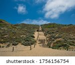 A Sandy Footpath On A Hill Wit...