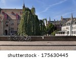 Bicycles on the pavement near channel in Brugges, Belgium  - stock photo