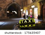 Taxi Car On The Street In...