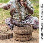 Small photo of Fakir Snake charmer playing Flute musical instrument before King Snake cobra dance