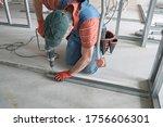 Worker Screws The Screw Into...