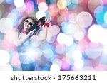young pretty girl dj at disco... | Shutterstock . vector #175663211