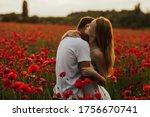 Loving Couple In The Poppy...