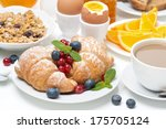 breakfast with croissants  eggs ... | Shutterstock . vector #175705124