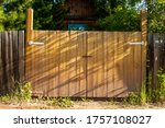 Yellow Wooden Gate Against The...