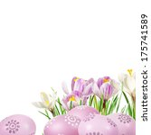 Small photo of Easter eggs aad crocuses in the grass isolated on white background.