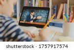 Small photo of Smart Little Boy Uses Digital Tablet for Video Call with His Teacher. Screen Shows Online Lecture with Teacher Explaining Subject from a Classroom. E-Education Distance Learning, Homeschooling