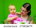 Mom giving a present a child - stock photo
