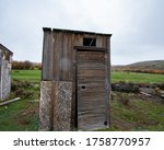 A Old Wood Outhouse On A Cattle ...