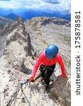 woman climbing top section of... | Shutterstock . vector #175878581