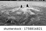 Two Sisters Having Fun In Lake
