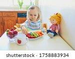 Adorable Toddler Girl Eating...